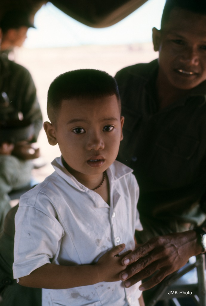 Young Vietnamese Boy at a Gathering to Offer Medical Help To he Vietnamese People